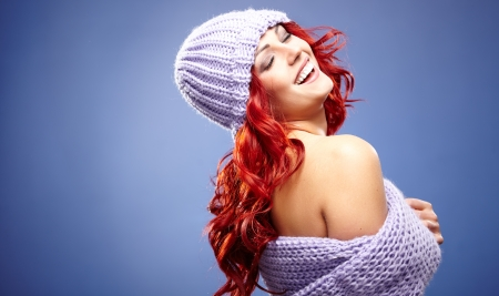 beautiful redhead woman in warm clothing  photo
