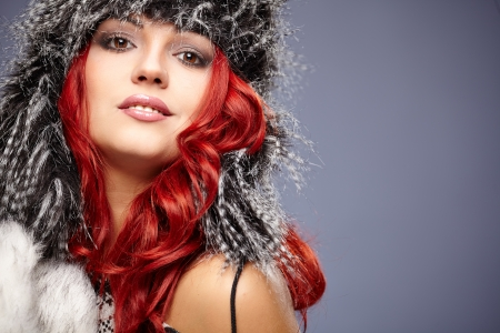 Fur Fashion  Beautiful Girl in Fur Hat  Winter Woman Portrait  photo