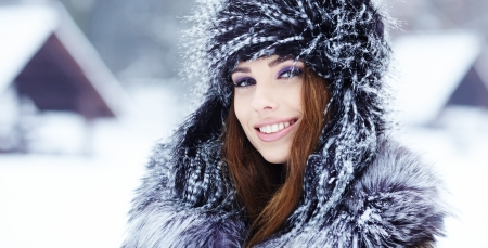 cool girl: Girl playing with snow in park