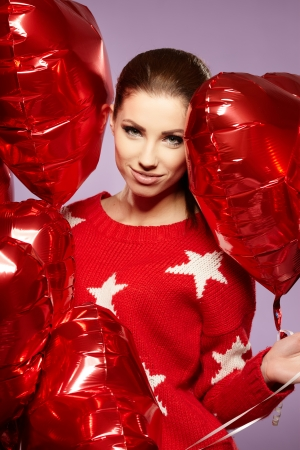 beautiful young woman with a heart-shaped balloons  photo