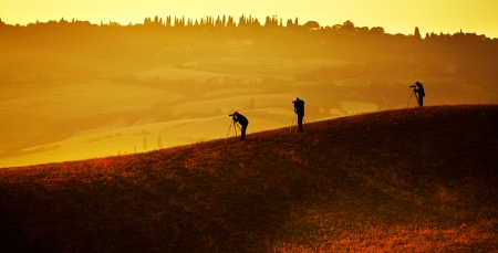 Silhouette of photographers on the background of the Tuscan hills photo