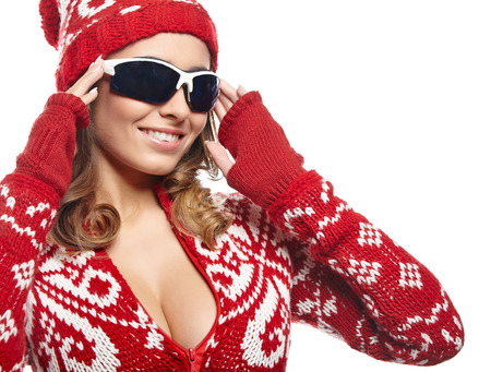 Sexy woman with ski goggles isolated on white  photo