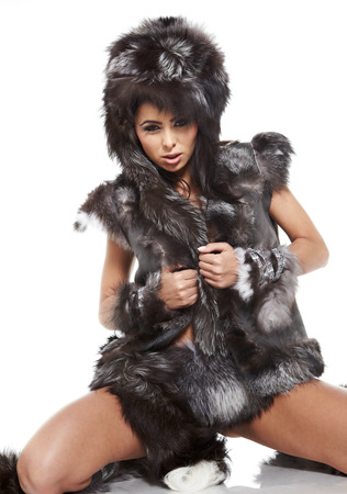 beautiful woman in barbarian costume at white background  photo