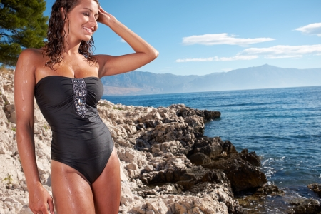 montenegro: A woman on a rocky beach in Croatia.