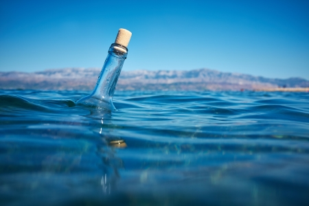 message in bottle: Bottle with a message in water