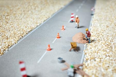 Road renovation in progress   Macro figurine Stock Photo