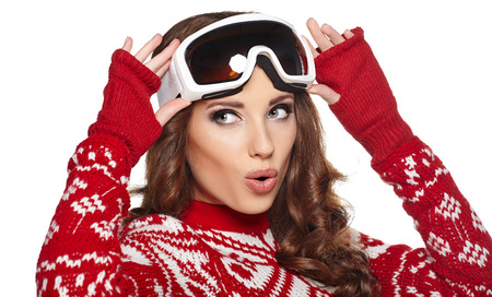 Woman with ski goggles isolated on white  photo
