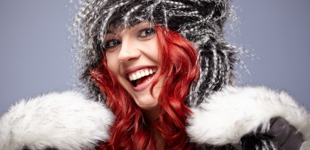 beautiful red hair woman in warm clothing  photo