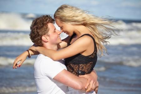 couple in love on the beach flirting  photo