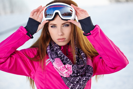 goggles: Happy young caucasian woman wearing ski goggles