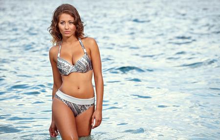 adriatic: Beautiful woman on the beach   Stock Photo