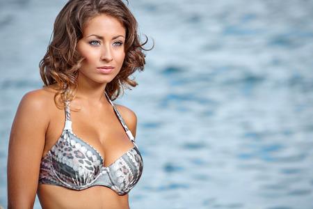 adriatic: Beautiful model relaxing on a beach