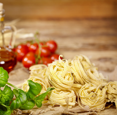 Italian food with vine tomatoes, basil, spaghetti photo