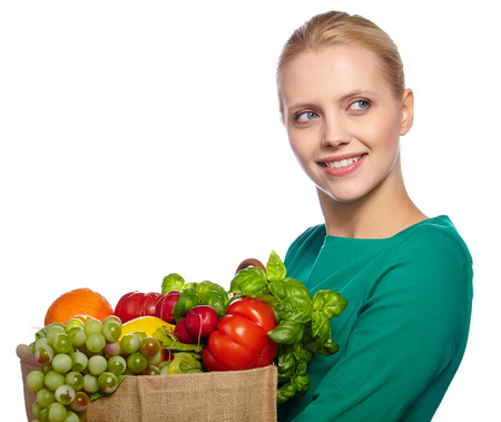 Young woman with a grocery shopping bag. Isolated on white background.  photo