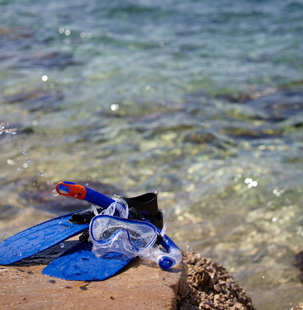 mask, snorkel and fins for snorkeling at the beach  photo