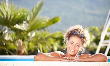 sexy girl in bikini lying near swimming pool. photo