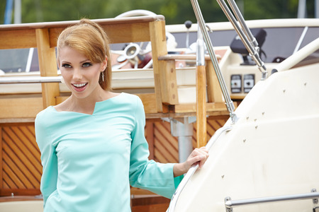 Beautiful fashion woman at the wooden old Yacht  photo