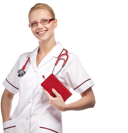 practioner: Close-up portrait of a female doctor smiling with arms crossed. Isolated on white background.