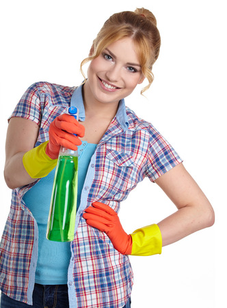 clean kitchen: young woman cleaning on white