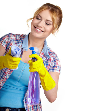 Spring cleaning woman pointing cleaning spray bottle. photo