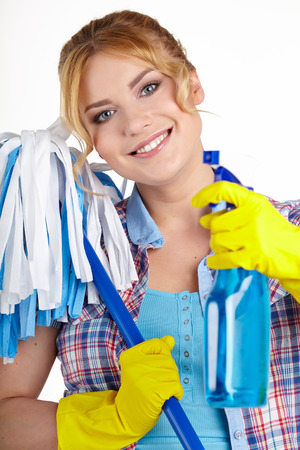 Housewife Ready To Fight With Spray Bottle and Mop  photo