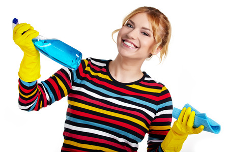Spring cleaning woman ready for spring cleaning smiling with rubber gloves and cleaning products  photo