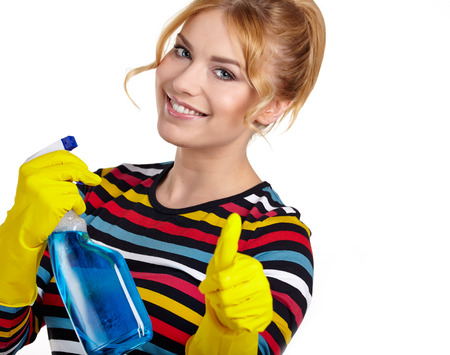 Young woman as a cleaning maid holding  liquids and showing OK sign, isolated over white  photo