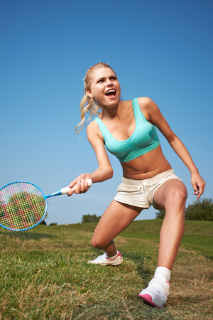 badminton player in action . Outdoor sport photo