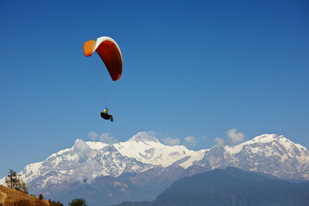 paragliding: paragliding in nepal with himalaya view and clear blue sky