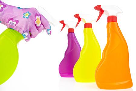 gloved hand holding a spray bottle  photo