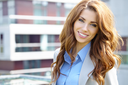 Young businesswoman  real estate agent  presenting detached modern houses