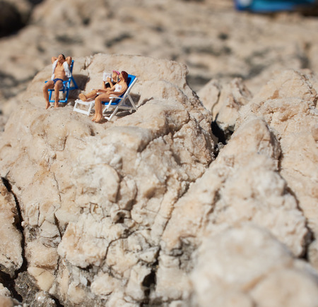 Miniature couple an a beach in swimming costume photo