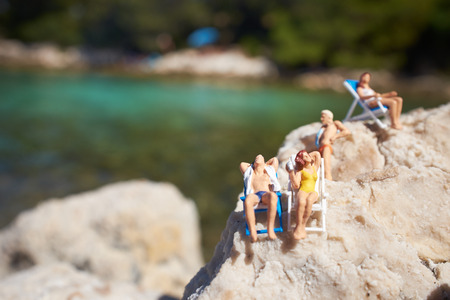 Miniature figurine an a beach in swimming costume photo