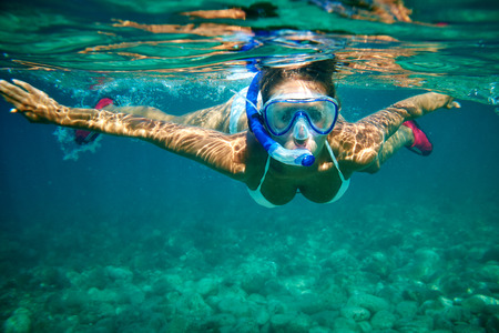 Young women at snorkeling in the tropical water  photo