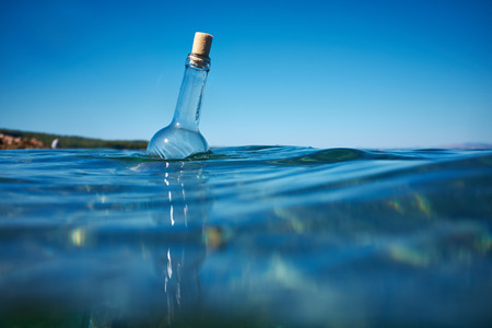 message in a bottle: Bottle with a message in water