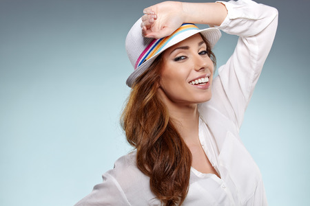 Smiling woman in studio portrait photo