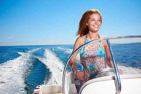 speedboat: Summer vacation - young girl driving a motor boat
