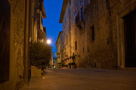 lonely road: Illuminated Street of Pienza after rain at Night, Italy