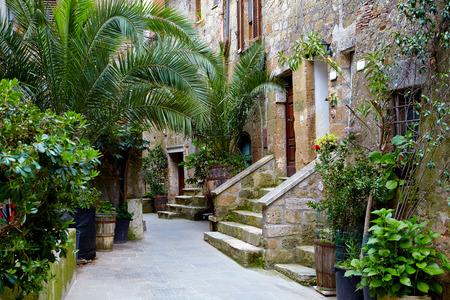 broken brick: Narrow Alley With Old Buildings In Italian City
