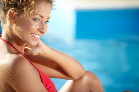 water hottub: beautiful sexy female model posing by the pool, outdoor portrait  Stock Photo