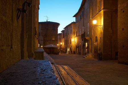 street lamps: Illuminated Street of Pienza after rain at Night, Italy