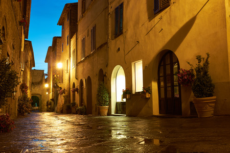 Illuminated Street of Pienza after rain at Night, Italy photo