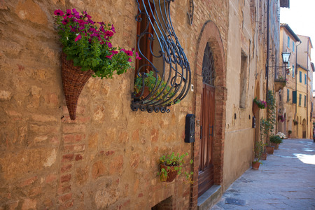 quaint: Vintage street decorated with flowers, Tuscany, Italy