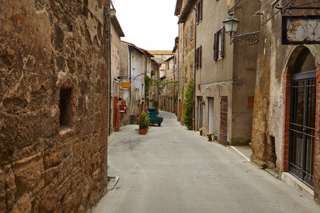 italian village: Vintage street decorated with flowers, Tuscany, Italy