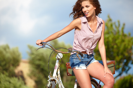 sexy woman: Sexy woman with vintage bike in a country road.