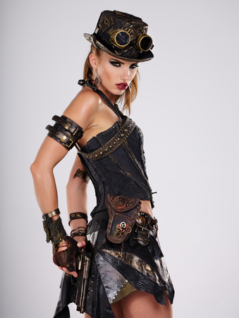 Steampunk isolated woman. Fantasy fashion for cover. photo