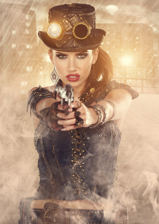 Steampunk woman. Fantasy fashion for cover. photo