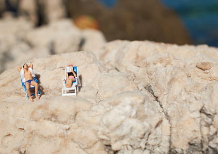 swimming costume: Miniature couple an a beach in swimming costume