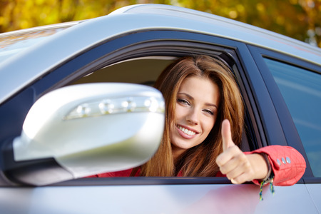 test drive: Happy smiling woman with car key  Driving