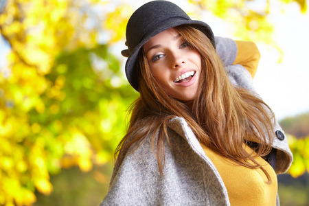 Fashion woman walking in autumn park  photo